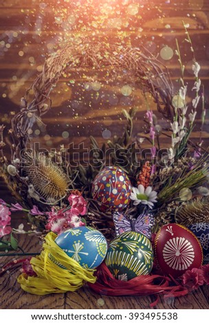 Easter background. colored Easter eggs and composition of dried flowers and plants. on wooden background. easter theme. happy easter. soft light effect