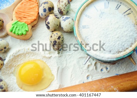 Easter background.Easter cooking.Easter cookies , willow branches on wooden background.Place for text.