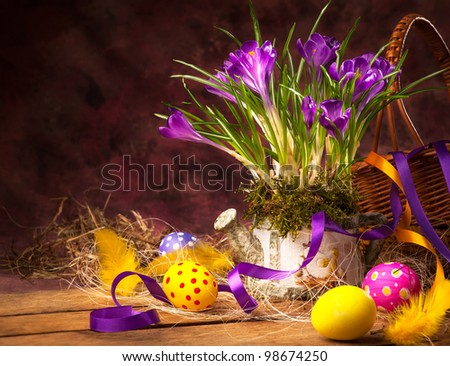 Easter background with crocuses and Easter eggs - stock photo