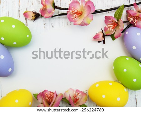 easter background with easter eggs and flowers - stock photo