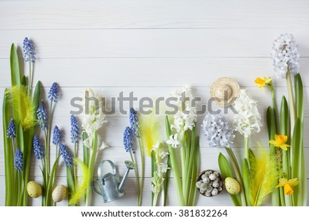 Easter background with flowers hyacinths, daffodils and eggs - stock photo