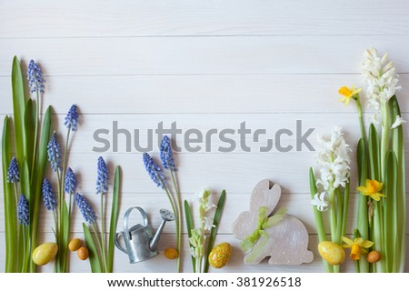 Easter background with flowers hyacinths, daffodils, eggs and rabbit - stock photo