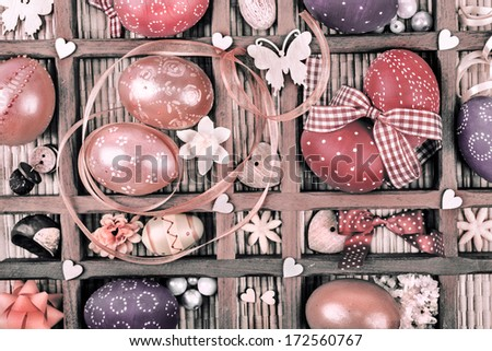 Easter background with painted eggs and small objects in a frame