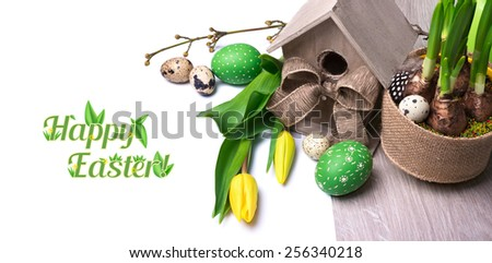 Easter banner with birdhouse, yellow tulips and Easter eggs, isolated white background for your text or caption - stock photo