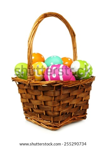 Easter basket filled with colorful eggs on a white background - stock photo