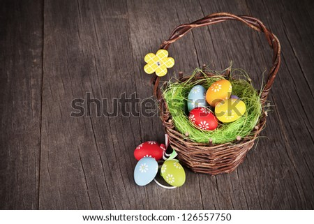 Easter basket on wooden table - stock photo