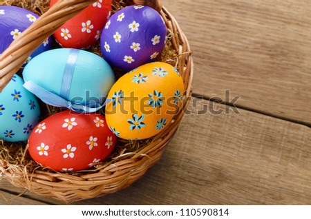Easter basket with decorated eggs - stock photo