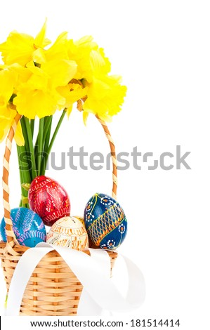 Easter basket with eggs and flowers on white - stock photo