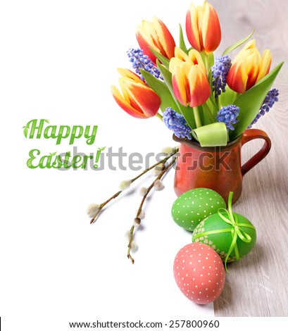 Easter border with spring flowers and Easter eggs isolated on white, space for your text on the right - stock photo