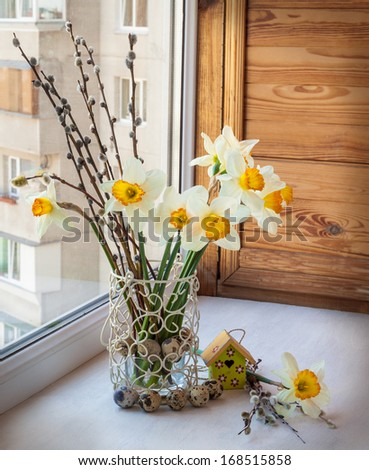 Easter bouquet of daffodils and willow twigs on the balcony - stock photo