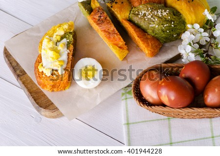 Easter bread with eggs and cherry branches,  - stock photo
