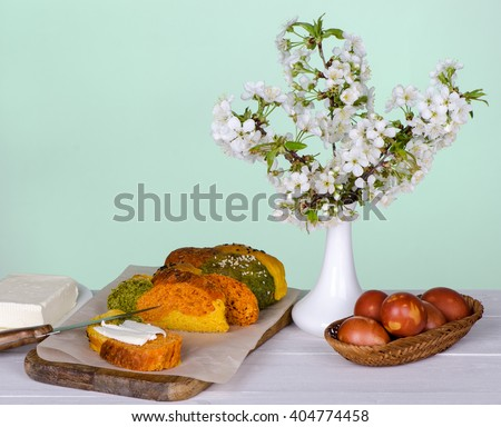 Easter bread with eggs and cherry branches - stock photo