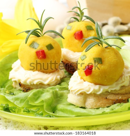 easter breakfast. Chickens made from egg yolk with mayonnaise put on slice bread - stock photo