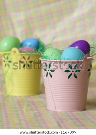 Easter buckets with colorful eggs.