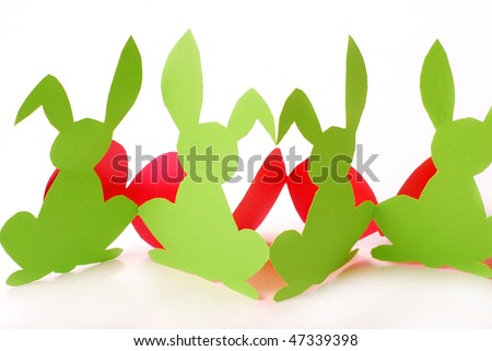 easter bunnies and eggs shapes cut-out from paper