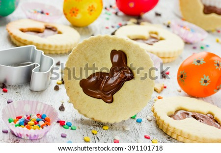 Easter bunny cookies colorful sprinkling and decorative eggs selective focus - stock photo