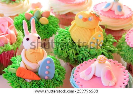 Easter bunny cupcakes with Easter eggs and a chick made of fondant.  - stock photo