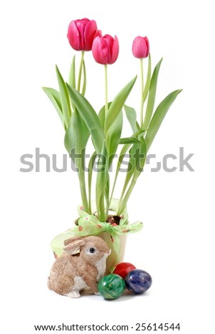 Easter bunny, eggs and tulips - stock photo