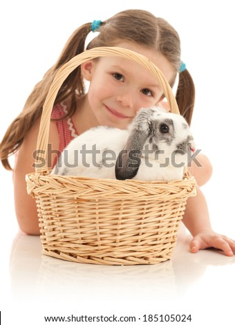 Easter Bunny in wooden basket with little girl in background