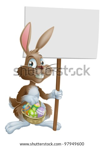 Easter bunny rabbit holding a basket of Easter eggs and a sign - stock photo