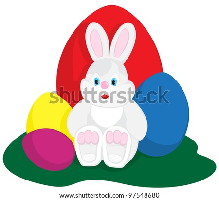 Easter bunny sitting with colored eggs on green - stock photo