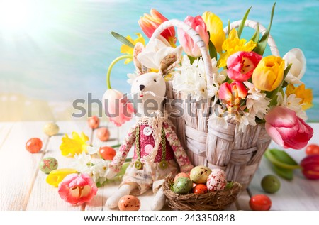 Easter bunny,spring flowers and chocolate eggs - stock photo