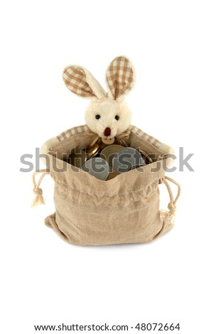 Easter Bunny with a full bag of coins, isolated on a white background