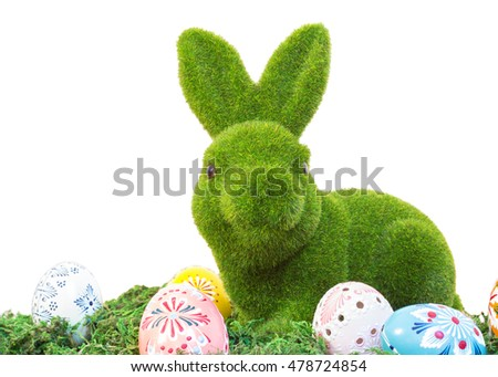 easter bunny with eggs on grass