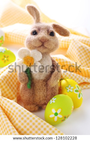 Easter bunny with painted Easter eggs.