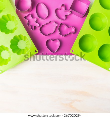 Easter cake mould with cookie cutter  on white wooden background,top view,place for text  - stock photo