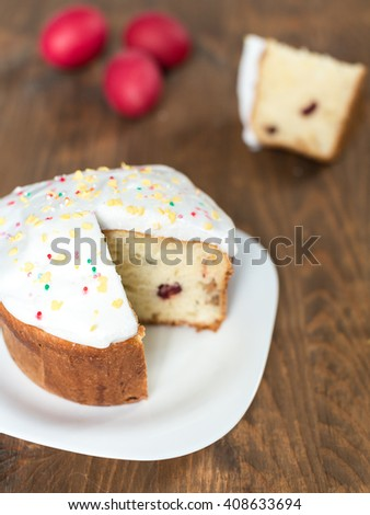 Easter cake on the plate on the wooden table