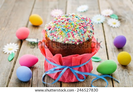Easter cake with colorful topping on a wood background. tinting. selective focus - stock photo