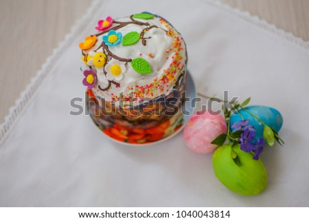 Easter cake with eggs and a flower vinca, periwinkle. Easter background. Self-baked Easter cake. Orthodox Traditions and Holidays