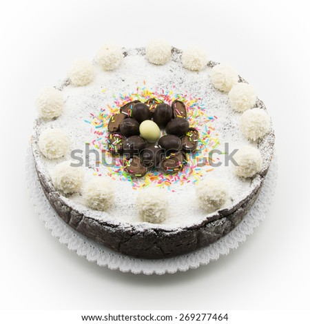 Easter cake with ricotta and chocolate decorated with chocolate eggs and powdered sugar - stock photo