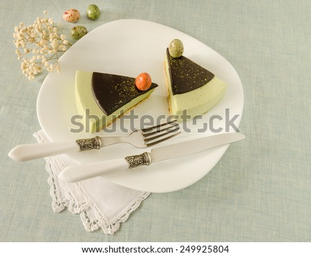 Easter cake with tea matcha decorated chocolate ganache and sweet-stuff eggs. Near cup of coffee.  - stock photo