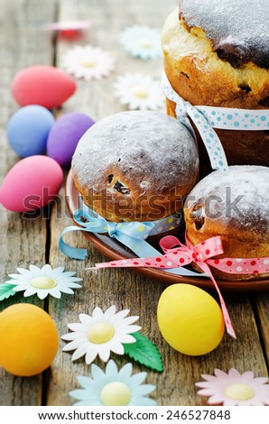 Easter cakes in the plate on a dark wood background. tinting. selective focus