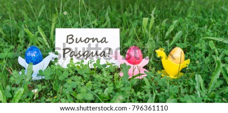 Easter card with colorful Easter eggs and italian text: happy easter