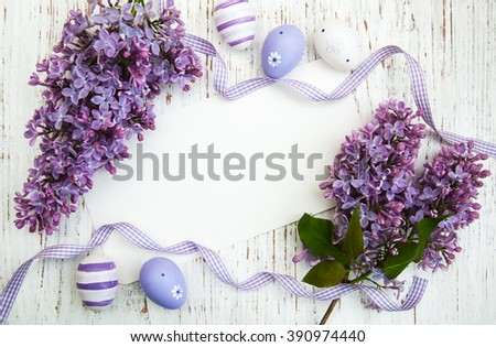 Easter card with easter eggs and lilac flowers - stock photo