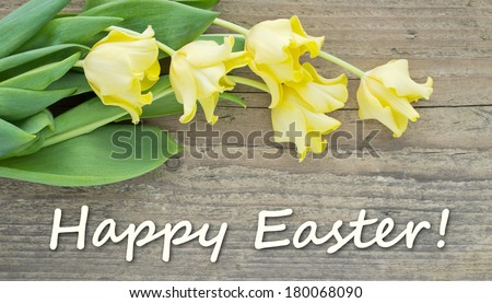 Easter card with yellow tulips/Happy easter/english - stock photo