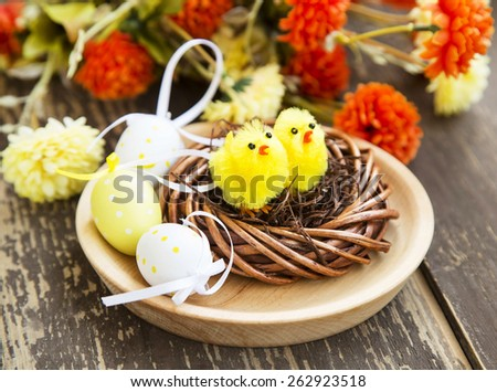Easter Chicken Nest with Easter Eggs and Flowers - stock photo