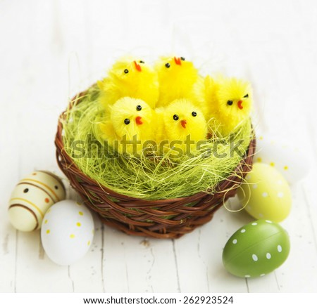 Easter Chicken Nest with Easter Painted Eggs and Little Chickens - stock photo