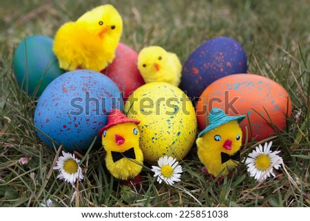 Easter chicks decorations with eggs - stock photo