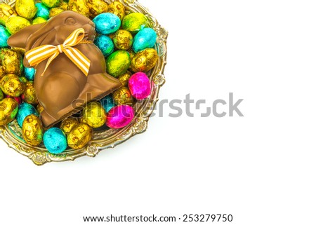 Easter chocolate bunny and Easter eggs on white background - stock photo