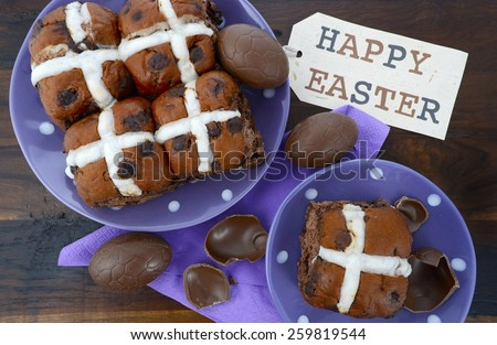 Easter chocolate hot cross buns on dark wood table.  - stock photo