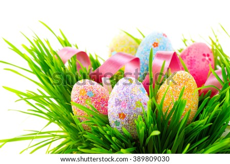 Easter colorful eggs and decorations on green spring grass isolated on white background. Beautiful border design