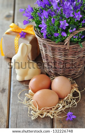 Easter composition on a rustic wooden table - stock photo