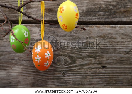 Easter composition on wooden background - stock photo