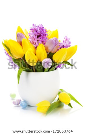 Easter composition with Beautiful spring flowers in vase over white