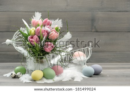 easter composition with eggs and pastel tulip flowers. nostalgic home interior. retro style colored picture - stock photo