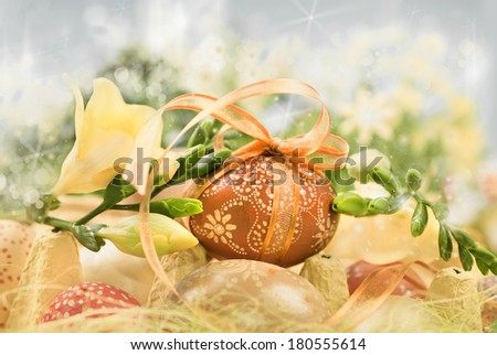 Easter composition with eggs and spring flowers, shallow DOF, text space  - stock photo
